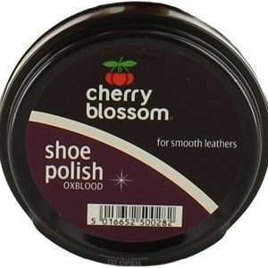 a cylinder structure with black and purple colour is having a cherry blossom , shoe polish text on the top of it