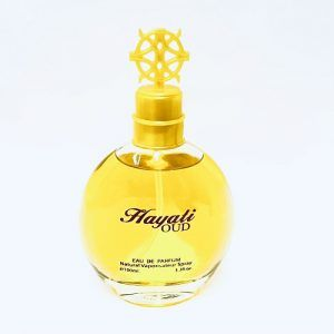 yellow colored bottle on which it is written hayali oud on it